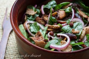 Pita & Spinach salad with dates and almonds